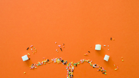 Spray with colored Rainbow and marshmallow Sprinkles creative concept. Stock Photo