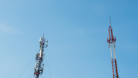 Telecommunications equipment - directional mobile phone antenna dishes. Wireless communication and blue sky