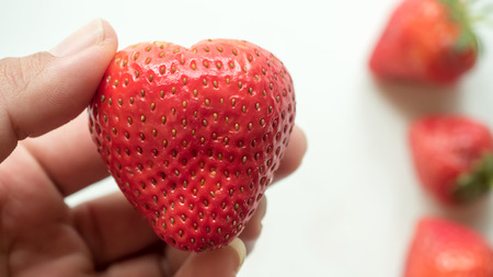close up hand hold Strawberry