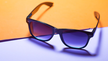 Black glasses on multi-colored background close up Stock fotó