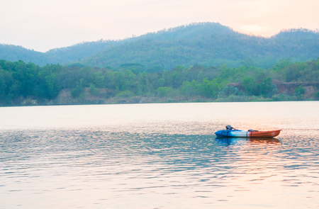 canoes on river background mountain