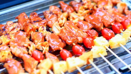 Meat With Pepper And Tomato On The Hot Charcoal BBQ Grill  Close Up