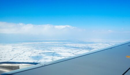 view from the airplane window, snow floor at japan Reklamní fotografie