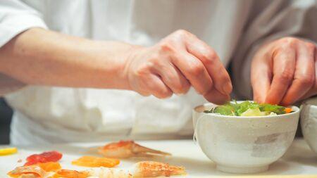 Japanese chef making sashimi in kitchen Imagens
