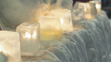 ice candle in snow