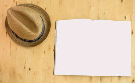 plan your trip concept topview book and hat on wood background Imagens