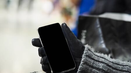 Woman hand holding the white smartphone Imagens