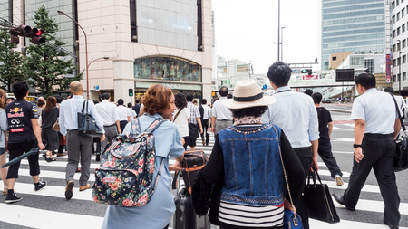 People crossing the street in japan. Blur background Editorial