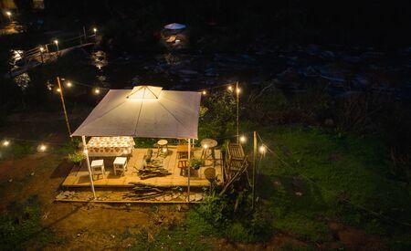 Tents and lanterns illuminate the night