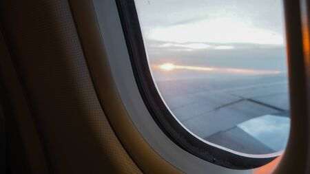Beautiful scenic city view of sunset through the aircraft window Reklamní fotografie