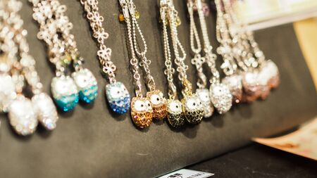 Traditional japan necklaces, handmade souvenirs at marketplace.
