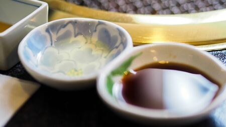 Cup of soy sauce close up