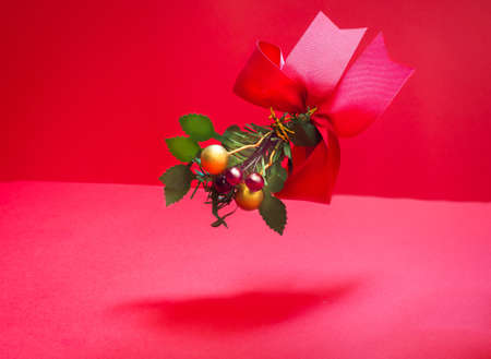 Red ribbon bow with green leaf and cherry decoration christmas