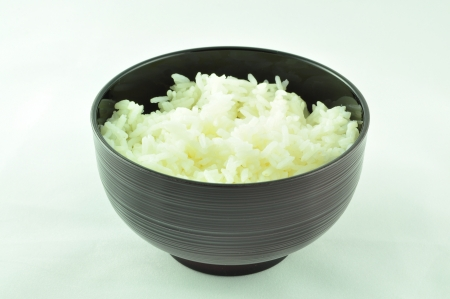 lacquer ware: Japanese Black Veined Bowl with Rice Stock Photo