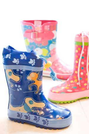 Blue and pink childrens rain boots. path included. photo