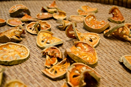 Dried bael fruit on basket Stock Photo