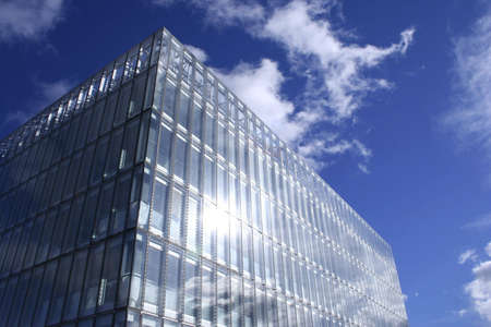glint: Sunshine and clouds reflect of a new office building in Glasgow, Scotland Stock Photo