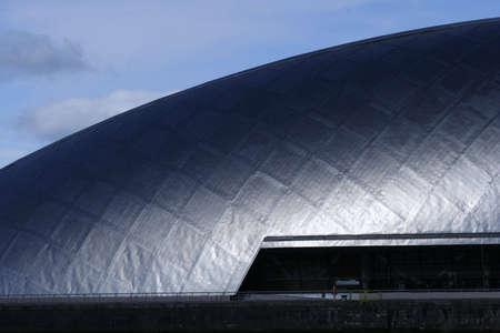 Titanium: The titanium cladding of the Glasgow Science Centre in the sunshine