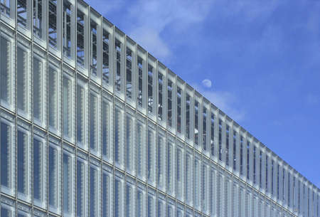frontage: The Moon rises over the frontage of a new office building