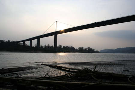 slipway: The Erskine Bridge over the River Clyde with the slipway of the old Erskine ferry in the foreground
