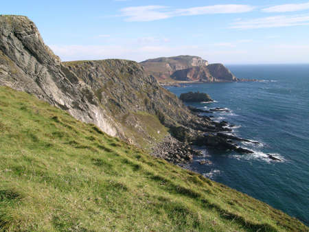 mull: The craggy coastline of the Mull Of Oa on Islay, Scotland Stock Photo