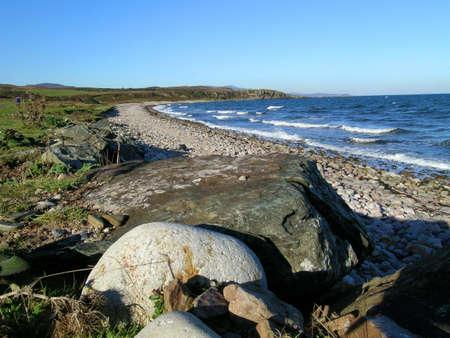 shingle beach: Shingle beach at Claggain Bay near sunset on Islay, Scotland Stock Photo