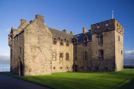 impregnable: Newark Castle, lit by a low sun, Port Glasgow, Scotland Stock Photo