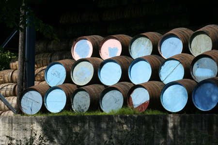 cask: Whisky barrels stored in a scottish distillerys warehouse