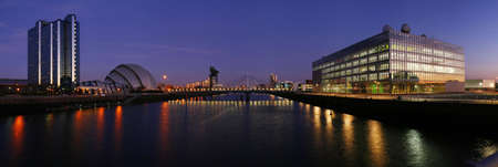 The modern skyline of Glasgows River Clyde at dusk photo