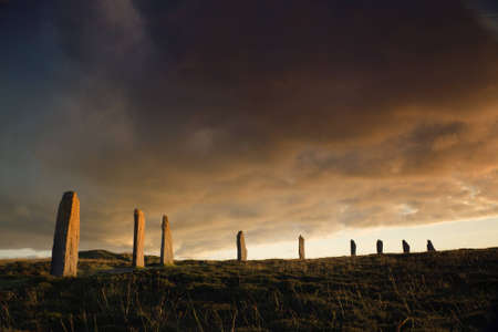 edifice: Ring of Brodgar in dramatic evening light and cloudscape