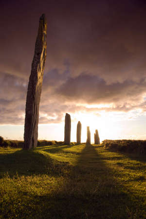 obelisk stone: Ring of Brodgar in dramatic evening light and cloudscape