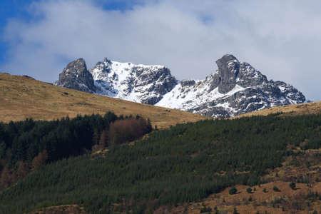 craggy: The craggy peak of The Cobbler, a famous Scottish mountain near Arrochar