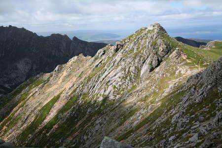 The granite peak of North Goatfell in Arran, Scotland photo