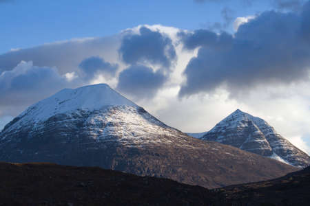 Two snowy Scottish peaks in evening sunlight Stock Photo - 4561458