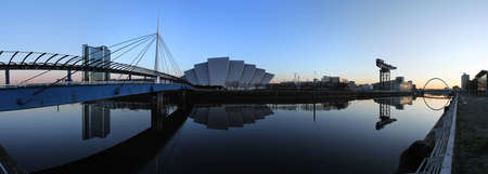 The modern skyline of Glasgows River Clyde at dawn photo