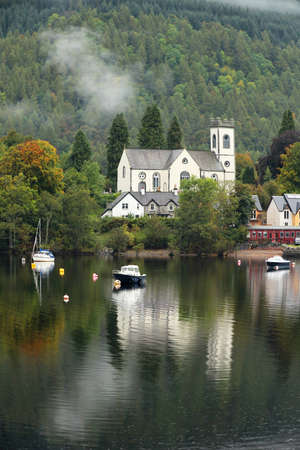 tay: Kenmore Church and Loch Tay on a misty day Stock Photo