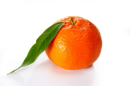Tangerine on a white background with leaves Stock Photo