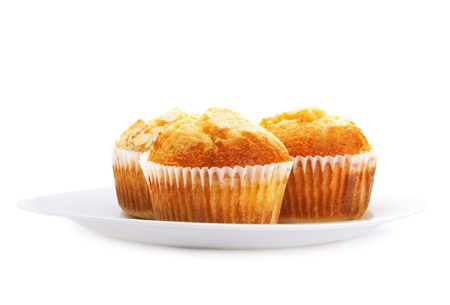 Three muffins in a plate, isolated on white Stock Photo - 17918032