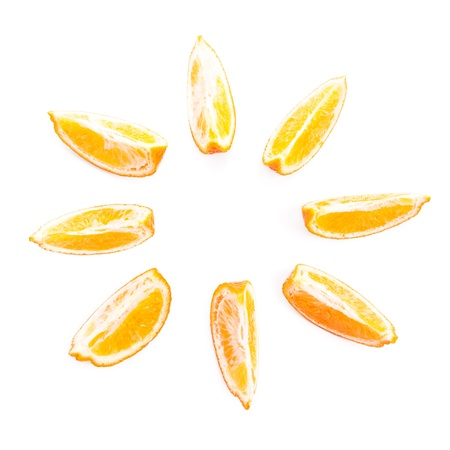 Eight slices of tangerine isolated on white background, close-up, in the form of the sun Stock Photo - 17918033