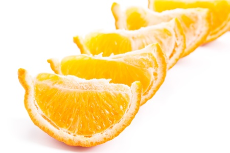 Slices of tangerine isolated on white background, close-up Stock Photo - 17918046