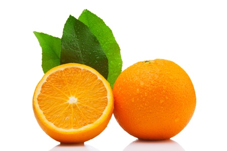 Whole and half orange, with three leaves. Isolated on white background
