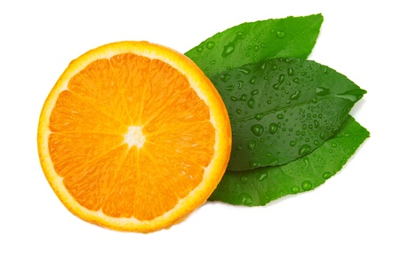 Half of orange and three leaf on a white background. Top view