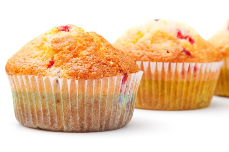 Several cupcakes closeup. Isolated on white background