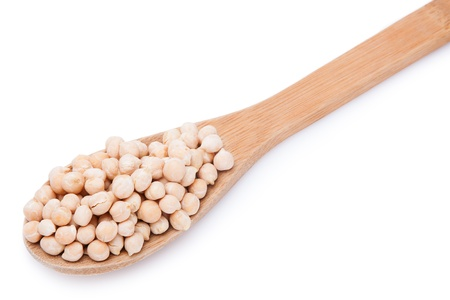 Chickpeas in a wooden spoon. Isolated on white background Stock Photo