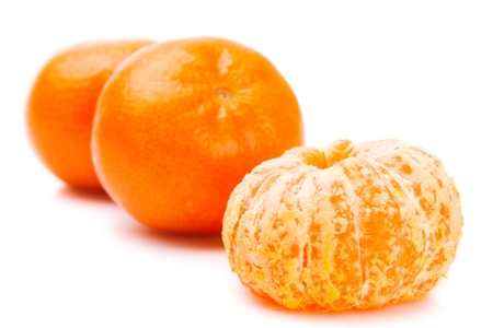 Two ripe tangerine with peel , and one peeled over white background Stock Photo