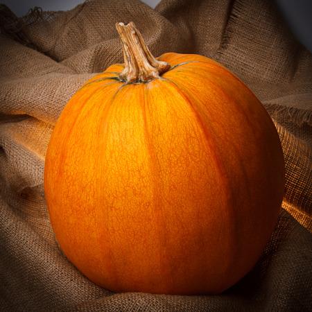 Orange pumpkin on the sackcloth Stock Photo