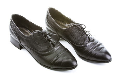 Black female shoes with laces. On a white background