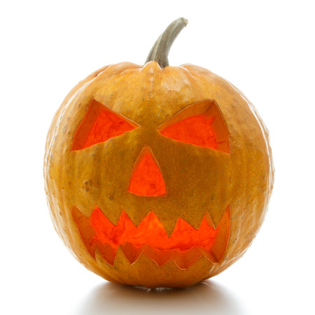 Glowing Halloween pumpkin isolated on white background Stock Photo