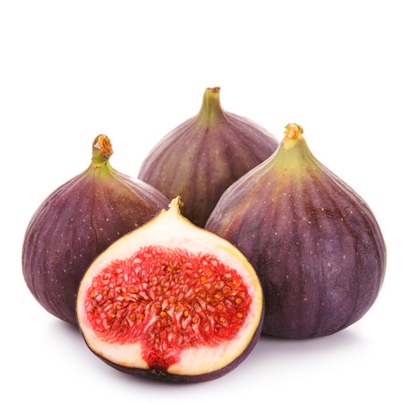 Four fresh figs isolated on white background. Half cut figs Stock Photo