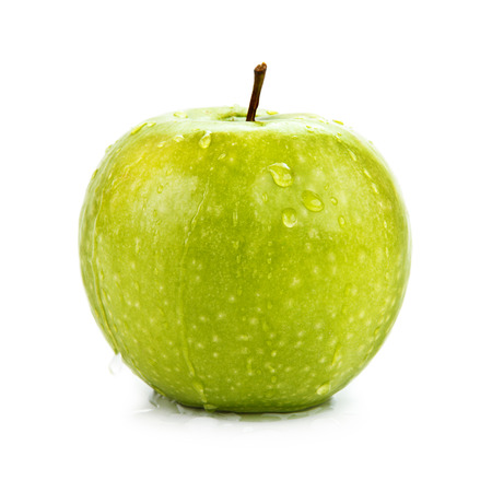 Wet green apple isolated on white. Stock Photo
